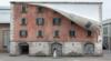 Alex Chinneck unzips a building in Milan's Tortona district