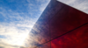 Olson Kundig's Jordan Schnitzer Museum Reflects its Surroundings with Red Mirrored Glass