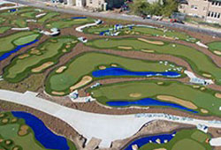 Arial view of synthetic grass landscape on a golf course with small bodies of water.